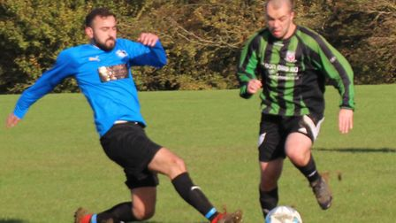 A Pinewood player avoids a Plough & Harrow defender's tackle. Picture: BRIAN HUBBALL