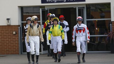 Jockeys heading out of the weighing room at Huntingdon Racecourse.