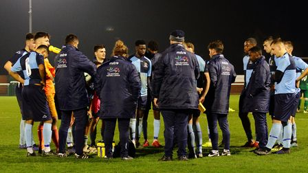 St Neots Town boss Marc Abbott addresses his players after their 0-0 draw at Biggleswade FC. Picture