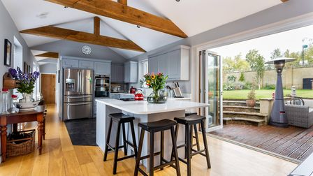 The stylish kitchen benefits from bi-folding doors to the large and well-landscaped rear garden. Pic