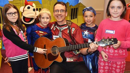 Guitarist John Hardwick.with youngsters from Junior Heroes Holiday Club in Royston. Picture: Alan Mi