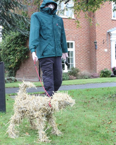 Foxton Scarecrow Festival 2019: The joint winner, 'Dog Walker', by the Elliott family. Picture: Simo
