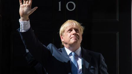 Boris Johnson waves on the steps of 10 Downing Street. Photograph: Dominic Lipinski/PA Wire.