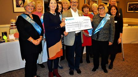 Martin Berry presents a cheque to Patsy Glazebrook with Dr Jane Hawking and members of the SCT Camb