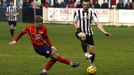 St Ives Town man Ben Jackson makes a challenge during their defeat at Bromsgrove Sporting. Picture: