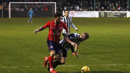 George Bailey is bundled over in the box to earn St Ives Town a penalty at Bromsgrove Sporting. Pict