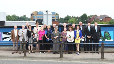 Local dignitries who were invited to unveil the timeline on Victoria Street bridge