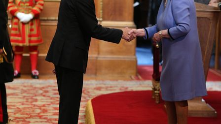 Dr Mike Ashmead from Great Cambourne is made an OBE by Queen Elizabeth II at Windsor Castle.Picture: