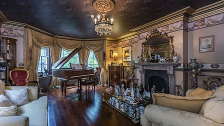 The home boasts its own piano room. Picture: John Curtis