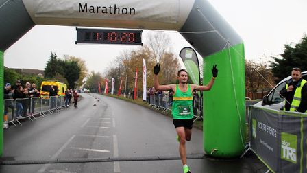 Hunts AC star Jamie Hall crosses the finish line to win the St Neots Half Marathon. Picture: SUBMITT