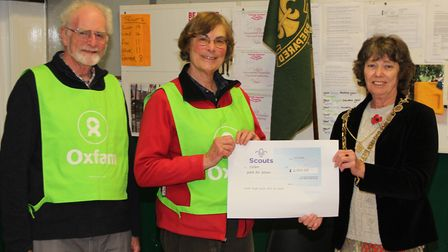 Mayor of St Albans Cllr Janet Smith presenting the cheque for 2,100 to Oxfam from St Albans scouts.