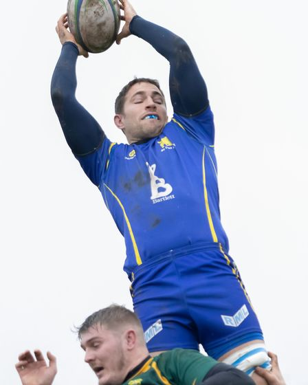 Skipper Ollie Bartlett claims a lineout for St Ives against Vipers. Picture: PAUL COX
