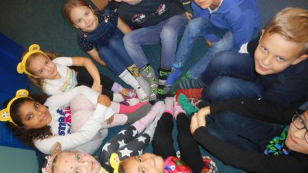 Pupils at Crosshall Junior School wore brightly coloured socks for Children in Need