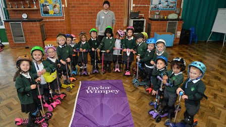 Pupils at Oakwood Primary School in St Albans with scooter trainer Lewis Mackrell. Picture: RKH