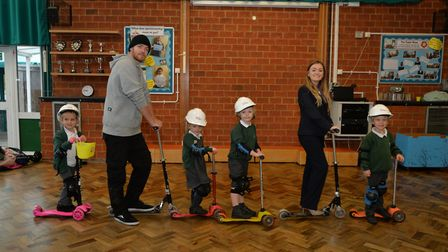 Pupils at Oakwood Primary School in St Albans with Jemma Tarabin from Taylor Wimpey and scooter trai