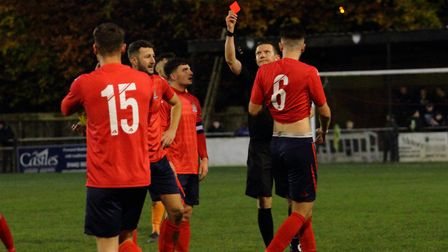 A red card is shown to St Neots Town player Jonny Butler (second left) at Berkhamsted. Picture: DAVI