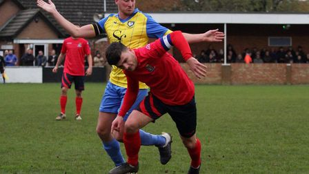 Captain Ben Bradley battles for the ball during St Neots Town's trip to Berkhamsted. Picture: DAVID