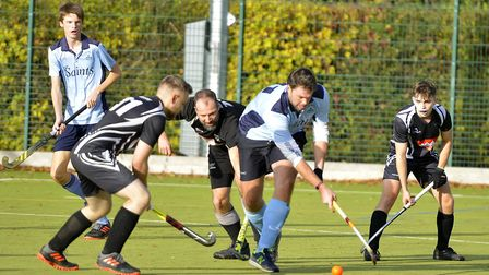 St Neots 1sts' player Mark Witherow is surrounded during their draw with Leadenham 1sts in the East