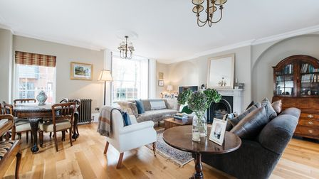 Period features include exposed beams and sash windows with shutters. Picture: Micahel Graham