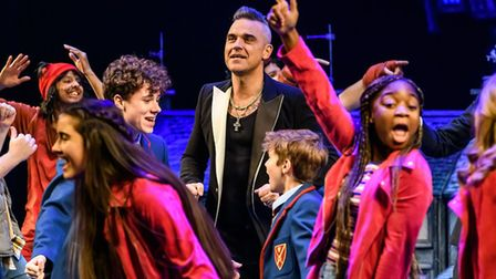 Robbie Williams joins the cast on stage following the opening night of The Boy in the Dress at The R