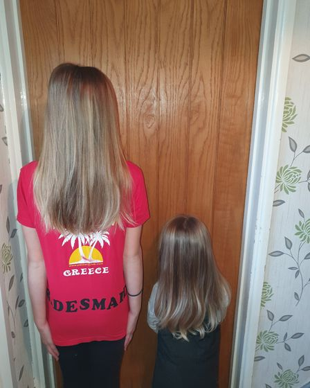 Iris Diment, aged 11 and Myia Parr, aged four, have had their hair cut to send to the Little Princes
