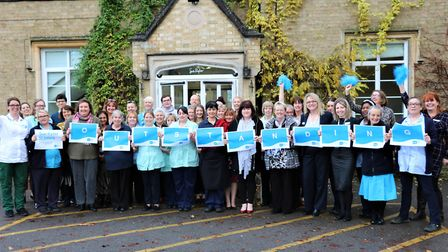 Sue Ryder St John's Hospice volunteers and staff come together to celebrate their 'Outstanding' rati