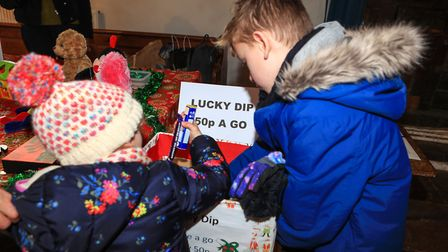 Lucky Dip for local siblings Thomas and Annabel at Ashwell Christmas Fayre 2019. Picture: KEVIN RICH