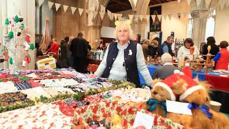 Liz from Letchworth selling her hand made bunting and shopping bags at Ashwell Christmas Fayre 2019.