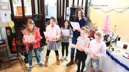 Carol singing by some of the St. MAry's Junior Choir at Ashwell Christmas Fayre 2019. Picture: KEV