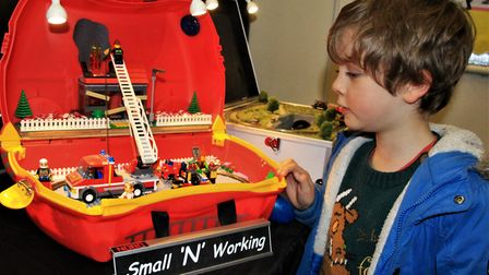 Young Thomas Dowle admires one of Ian Redman's miniature creations for small rooms. Picture: Clive P