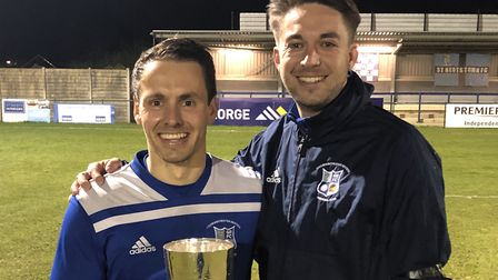 Godmanchester Rovers manager Ollie Drake (right) with captain Micky Hyem after winning the Hunts Sen