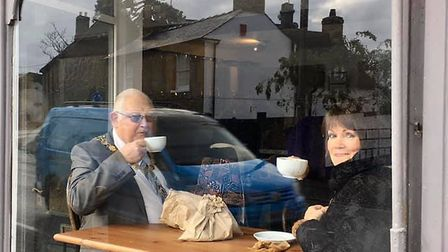 Cllr Thorpe and Cllr Green having a cup of coffee at the new shop.