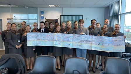 William at Titan Airways with staff and his artwork