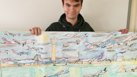William with his artwork on planes.