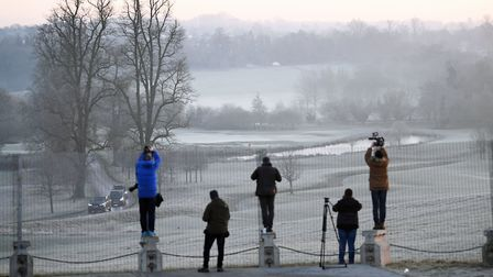 Photographers record the arrival of a motorcade at The Grove hotel in Watford, Hertfordshire, where