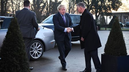 Prime Minister Boris Johnson arrives for the annual Nato heads of government summit at The Grove hot