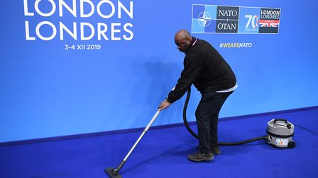 Staff clean the carpet ahead of the annual Nato heads of government summit at The Grove hotel in Wat
