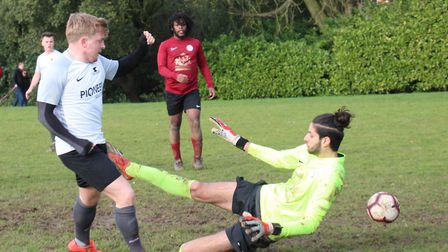 Charlie Hunter of Blacksmiths Res shoots past Manor keeper Michael Kenovan. Picture: BRIAN HUBBALL