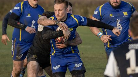 Alex Henly of St Ives attempts to break free from a Stewarts & Lloyds opponent. Picture: PAUL COX