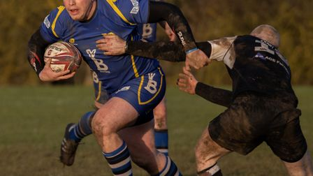 John Paxton runs with the ball as St Ives beat Stewarts & Lloyds last Saturday. Picture: PAUL COX