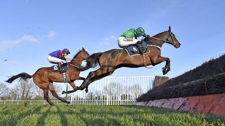 Winner Top Notch (right) and rival La Bague Au Roi jump a fence during the Fitzdares Peterborough Ch