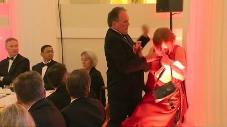 Mark Field manhandled a climate protester out of a banquet. Picture: PA Wire.