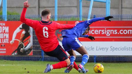 St Neots Town defender Tommy Boxer concedes a penalty during their trip to Halesowen. Picture: DAVID