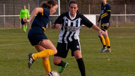 Ellie Lovelock looks on as Ellen Salter tries to find a way through for St Albans Ladies against Col