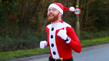 Stephen Hosty of St Albans Striders completes the Festive 5 in Welwyn Garden City dressed as Santa.