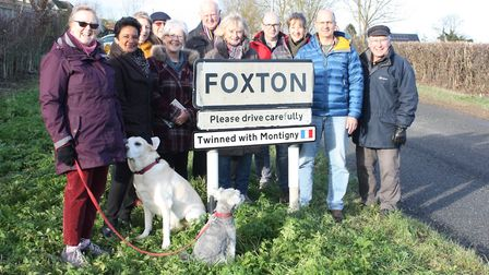 Members of Foxton Twinning Association gather around one of the new signs. Picture: Simon Buggey