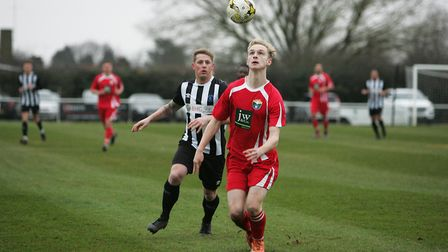 Colney Heath V London Colney - Harry Ronald in action for London Colney as Jon Clements closes in.