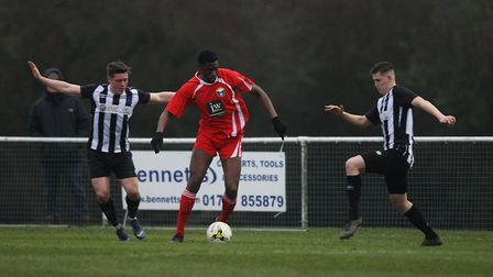 Colney Heath V London Colney - Harry Lewis and Chris Griffin close in on Timothy Obinsanya.Pictur