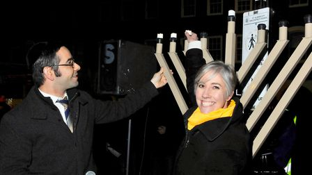 St Albans MP Daisy Cooper helped light the Menorah as part of St Albans United Synagogue's Chanukah