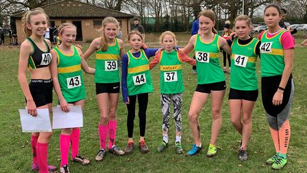 The Hunts AC Under 13 Girls squad, who won individual and team medals, are from the left, Isla Fullu